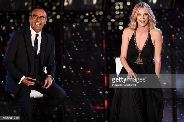 Carlo Conti and Charlize Theron attend second night 65th Festival di Sanremo 2015 at Teatro Ariston on February 11 2015 in Sanremo Italy