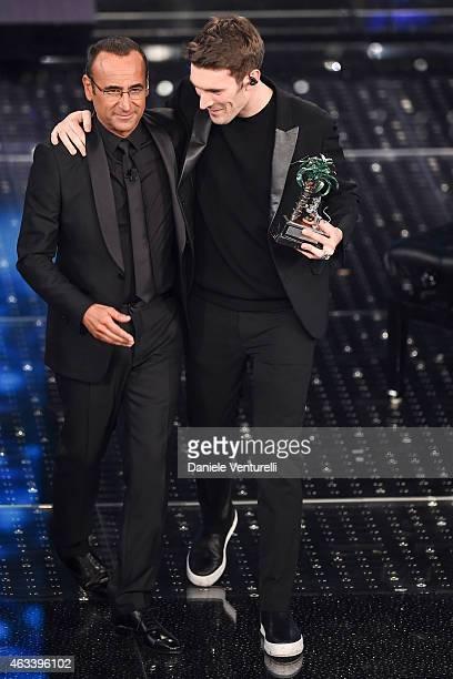 Carlo Conti and Giovanni Caccamo attend the fourth night of 65th Festival di Sanremo 2015 at Teatro Ariston on February 13 2015 in Sanremo Italy