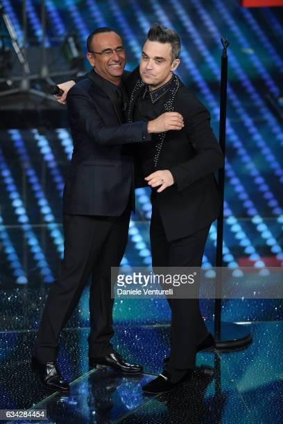Carlo Conti and Robbie Williams attend the second night of the 67th Sanremo Festival 2017 at Teatro Ariston on February 8 2017 in Sanremo Italy