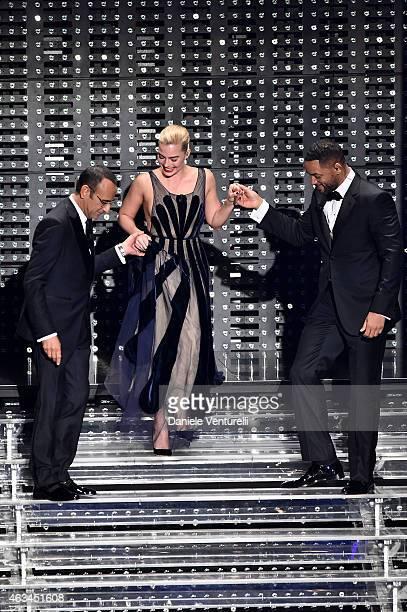 Carlo Conti Margot Robbie and Will Smith attend the closing night of 65th Festival di Sanremo 2015 at Teatro Ariston on February 14 2015 in Sanremo...