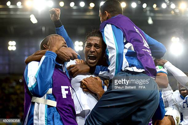 Carlo Costly of Honduras celebrates scoring his team's first goal with his teammates during the 2014 FIFA World Cup Brazil Group E match between...