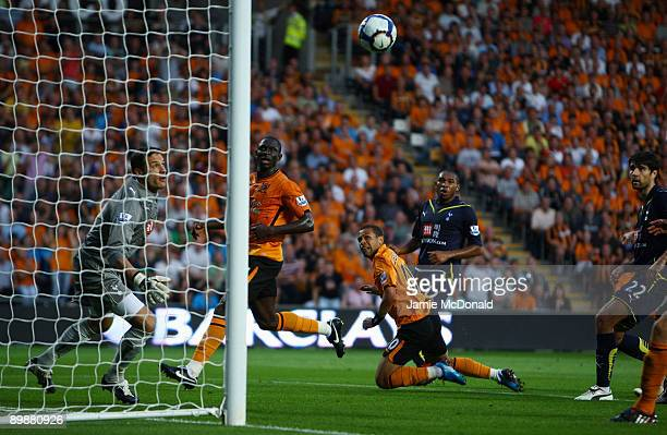 Carlo Cudicini of Tottenham Hotspur looks on as he is beaten by Stephen Hunt of Hull during the Barclays Premier League match between Hull City and...