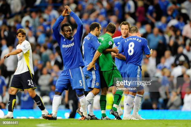 Carlo Cudicini the Tottenham goalkeeper is hugged by former Chelsea teammates following the final whistle during the Barclays Premier League match...
