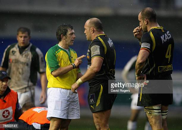 Carlo Damasco, the referee, warns Perpignan captain Perry Freshwater after he punched Kieran Roche during the Heineken Cup match between Perpignan...