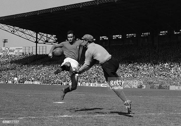 Carlo Galli of Italy and France's goalkeeper Rene Vignal during an international match between France and Italy