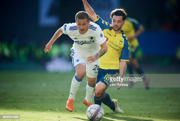 Carlo Holse of FC Copenhagen and Besar Halimi of Brondby IF compete for the ball during the Danish Alka Superliga match between FC Copenhagen and...