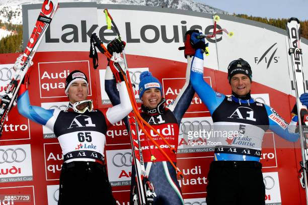 Carlo Janka of Switzerland 2nd place Peter Fill of Italy 1st place and Hans Olsson of Sweden 3rd place celebrate on the podium during the Men's...