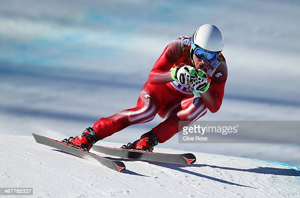 Carlo Janka of Switzerland skis during training for the Alpine Skiing Men's Downhill during the Sochi 2014 Winter Olympics at Rosa Khutor Alpine...