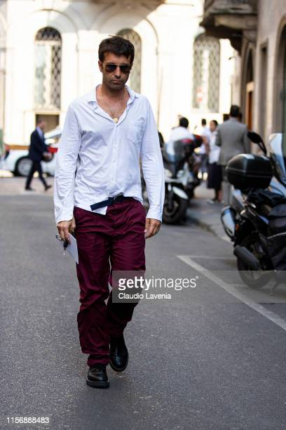 Carlo Mazzoni wearing a white shirt burgundy pants and black shoes is seen outside Giorgio Armani show during the Milan Men's Fashion Week...