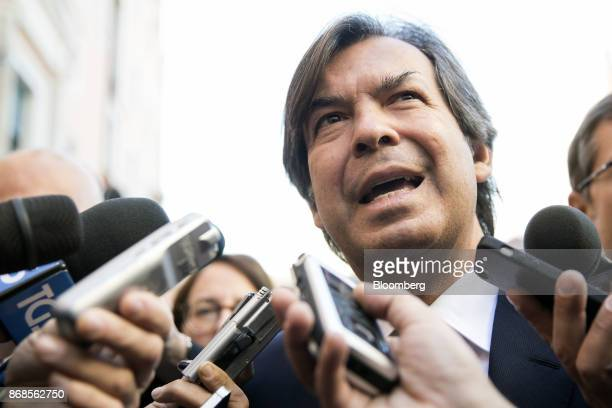 Carlo Messina chief executive officer of Intesa Sanpaola SpA speaks to reporters as he arrives for an event to mark World Savings Day at the Italian...
