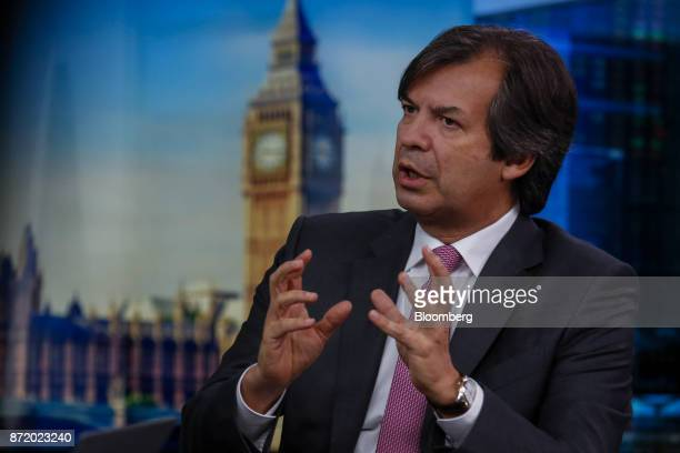 Carlo Messina chief executive officer of Intesa Sanpaolo SpA gestures while speaking during a Bloomberg Television interview in London UK on Thursday...