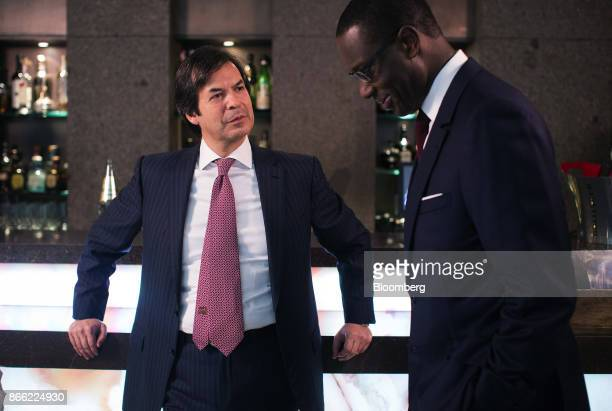 Carlo Messina chief executive officer of Intesa Sanpaolo SpA left pauses as he speaks with Tidjane Thiam chief executive officer of Prudential Plc...