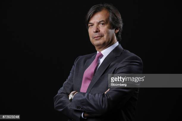 Carlo Messina chief executive officer of Intesa Sanpaolo SpA poses for a photograph following a Bloomberg Television interview in London UK on...