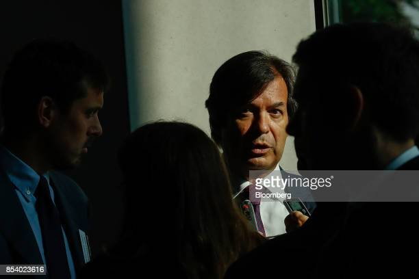 Carlo Messina chief executive officer of Intesa Sanpaolo SpA speaks to media at the Bloomberg European Banking Conference in Milan Italy on Tuesday...