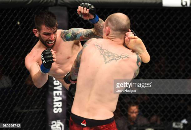 Carlo Pedersoli kicks Bradley Scott of England in their welterweight bout during the UFC Fight Night event at ECHO Arena on May 27 2018 in Liverpool...