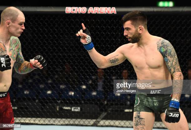 Carlo Pedersoli taunts Bradley Scott of England in their welterweight bout during the UFC Fight Night event at ECHO Arena on May 27 2018 in Liverpool...