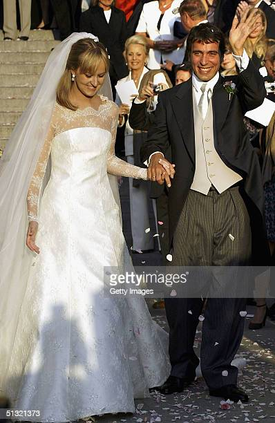 Carlo Ponti Jr leaves St Stephen's Basilica with his wife Andrea Meszaros after their marriage ceremony September 18 2004 in Budapest Hungary