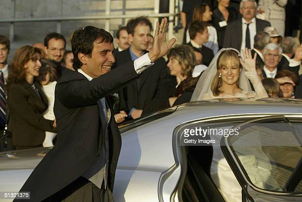 Carlo Ponti Jr leaves St. Stephen's Basilica with his wife Andrea Meszaros after their marriage ceremony September 18, 2004 in Budapest, Hungary.