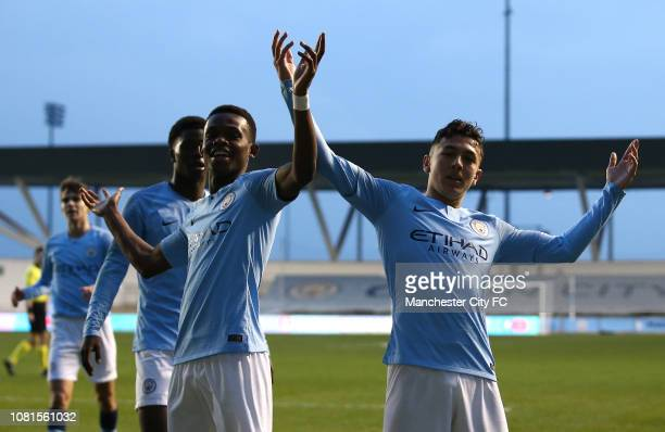Carlo Poveda of Manchester City celebrates scoring his sides second goal with team mates during the UEFA Youth League Group F match between...