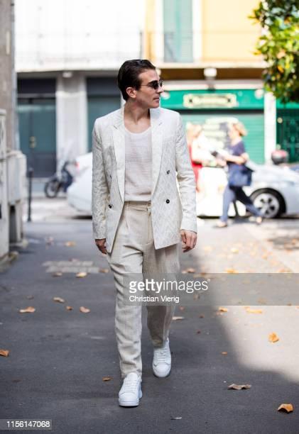 Carlo Sestini is seen wearing creme white suit outside M1992 during the Milan Men's Fashion Week Spring/Summer 2020 on June 15 2019 in Milan Italy