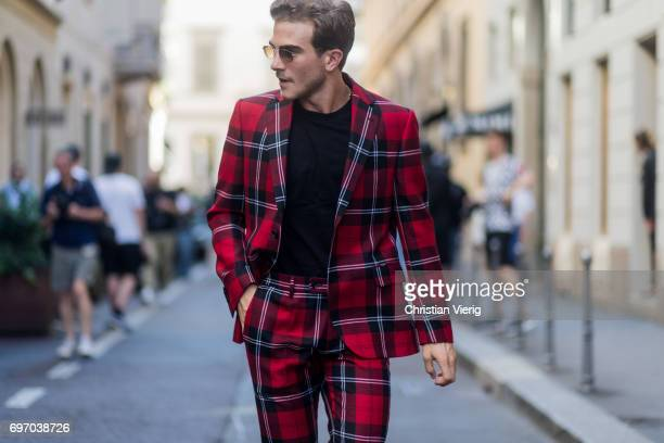 Carlo Sestini weairng a lumberjack checked suit is seen outside Versace during Milan Men's Fashion Week Spring/Summer 2018 on June 17 2017 in Milan...