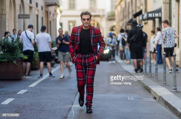 Carlo Sestini weairng a lumberjack checked suit is seen outside Versace during Milan Men's Fashion Week Spring/Summer 2018 on June 17 2017 in Milan...