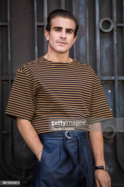 Carlo Sestini wearing a striped yellow and black t shirt and black Cerruti pants is seen in the streets of Paris before the Cerruti 1881 show during...