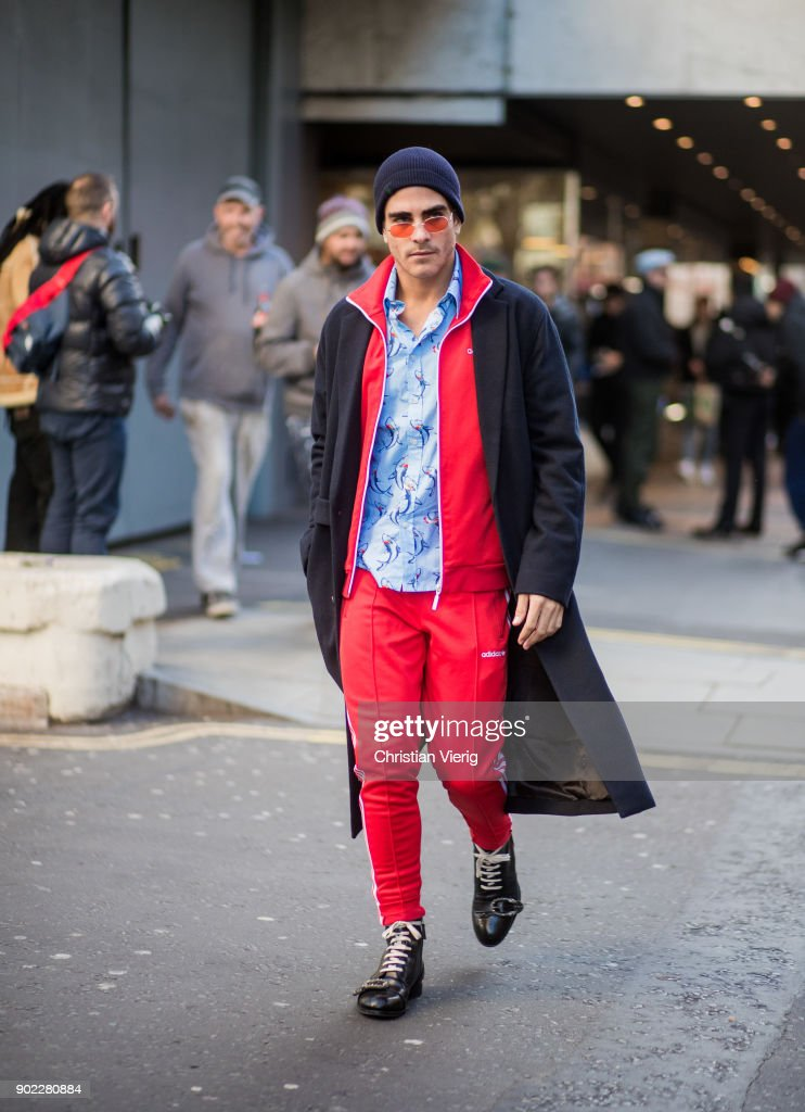 Carlo Sestini wearing Adidas track suit, beanie, wool coat during London Fashion Week Men's January 2018 on January 7, 2018 in London, England.
