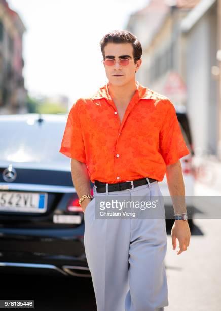 Carlo Sestini wearing orange button shirt, grey pants is seen outside AALTO during Milan Men's Fashion Week Spring/Summer 2019 on June 18, 2018 in...