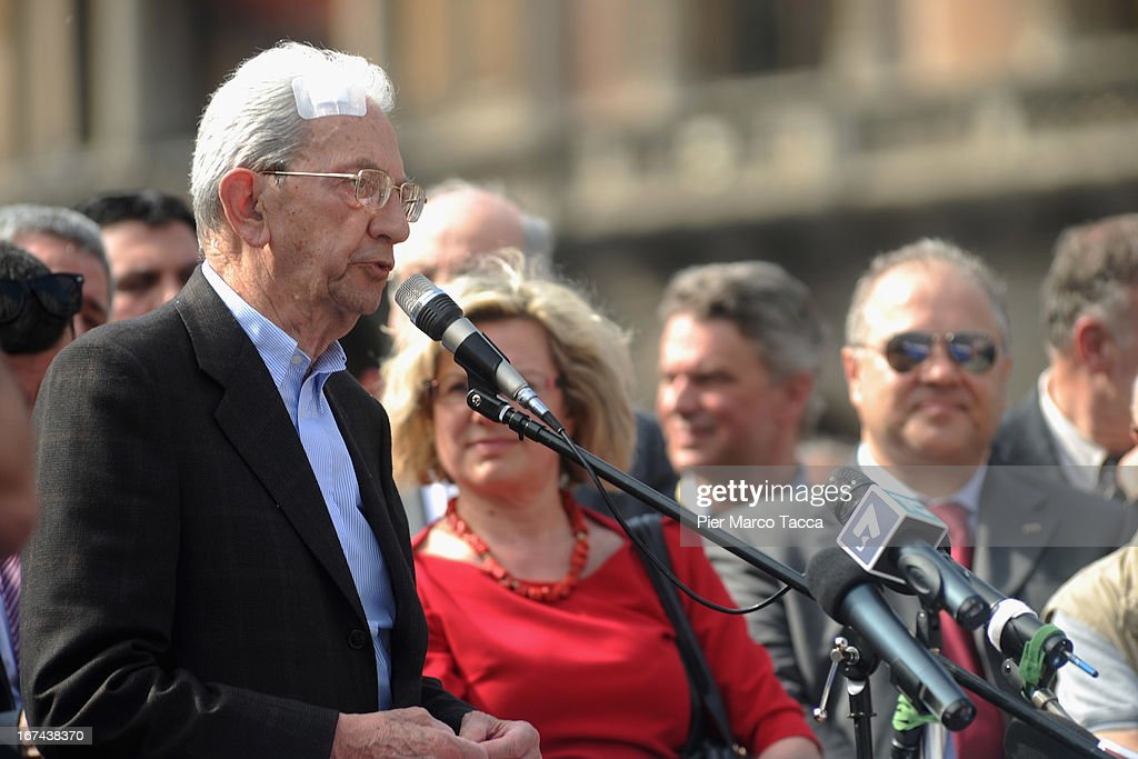 Carlo Smuraglia President of ANPI (National association of Italian Partisan) in Milan makes a speech in Duomo square during celebrations to mark the 68th Festa della Liberazione on April 25, 2013 in Milan, Italy.The symbolic celebration day commemorates the Liberation of Italy and the Italian resistance movement after the Nazi occupation army left Northern Italy on April 25, 1945.