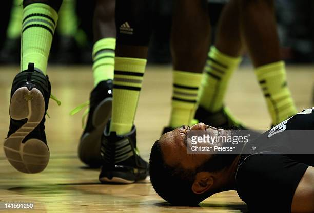 Carlon Brown of the Colorado Buffaloes lies on the ground hurt in the first half against the Baylor Bears during the third round of the 2012 NCAA...