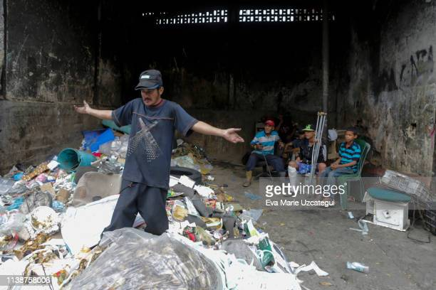 Carlos 30 years old looks for something to eat in Petare on April 10 2019 in Caracas Venezuela Political and economic crisis has triggered a food...