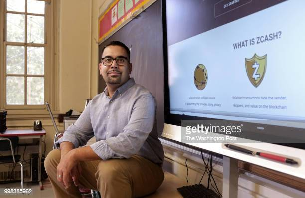 Carlos Acevedo a senior English teacher and technology coordinator at the Morris Academy for Collaborative Studies poses for a portrait next to a...