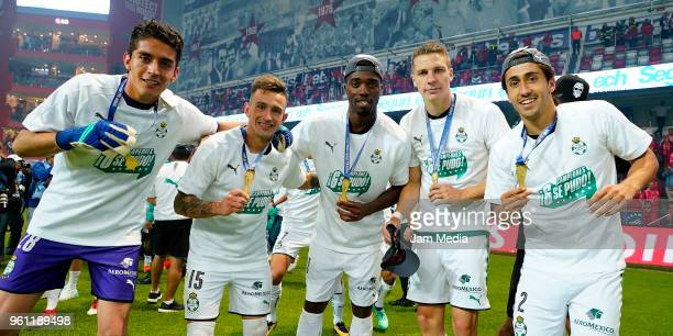 Carlos Acevedo Brian Lozano Djaniny Julio Furch and José Abella of Santos Laguna celebrates after winning the Final second leg match between Toluca...