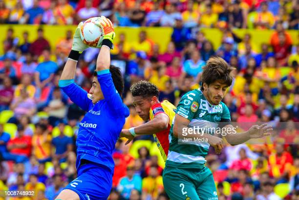 Carlos Acevedo of Santos Ray Sandoval of Morelia and Jose Abella of Santos compete for the ball during the second round match between Morelia and...