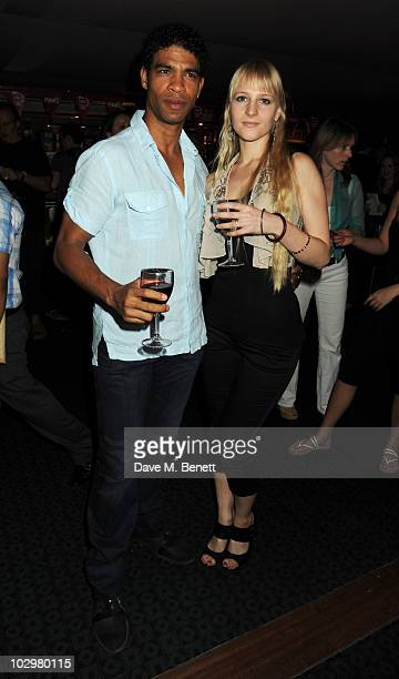 Carlos Acosta and Charlotte Holland attend the UK Premiere of 'South Of The Border' at The Curzon Mayfair on July 19 2010 in London England