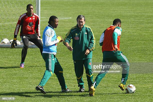 Carlos Alberto Gomes Parreira head coach of South African national football team gives instructions to his players during a training session of the...