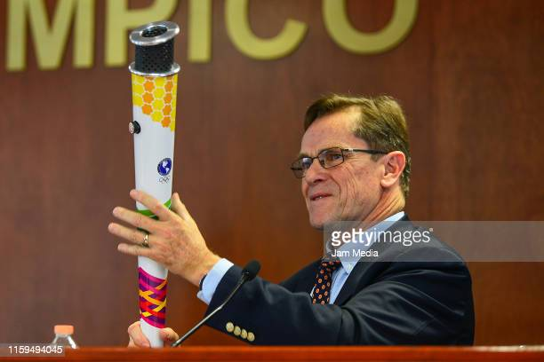 Carlos Alberto Neuhaus Tudela Organization Committee President of the XVII Summer Olympic Games Lima 2019 holds the torch during a Panam Sports press...