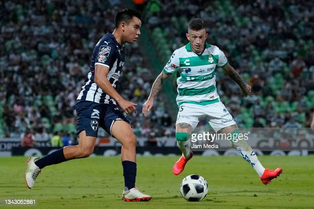 Carlos Alberto Rodriguez of Monterrey fights for the ball with Brian Lozano of Santos during the 10th round match between Santos Laguna and Monterey...
