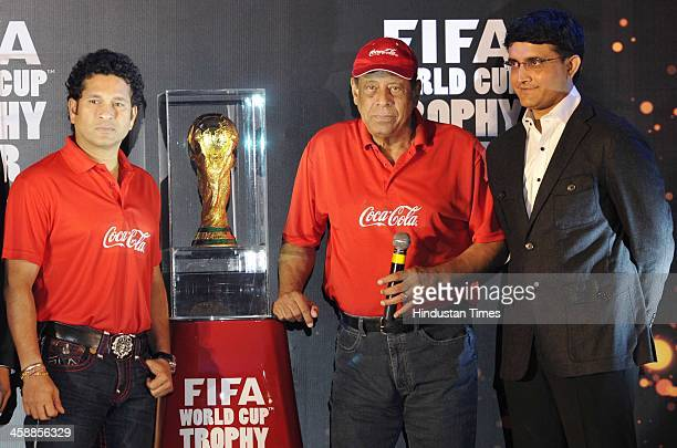 Carlos Alberto Torres former Brazilian World Cup captain unveils the FIFA World cup Trophy with Indian cricketers Sachin Tendulkar and Saurav Ganguly...