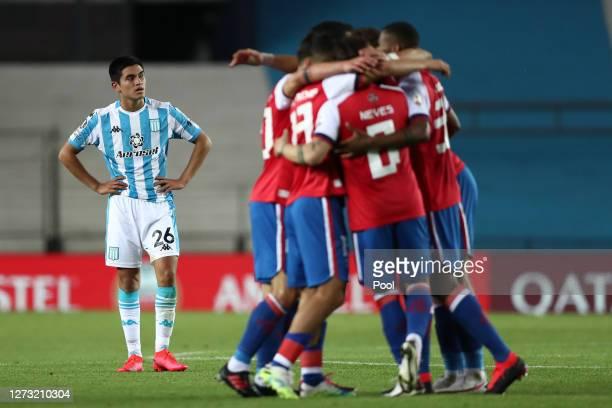 Carlos Alcaraz of Racing Club looks dejected as player of Nacional celebrate after a group F match of Copa CONMEBOL Libertadores 2020 between Racing...