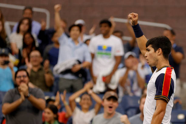 Carlos Alcaraz of Spain reacts against Peter Gojowczyk of Germany during his Men's Singles round of 16 match on Day Seven at USTA Billie Jean King...