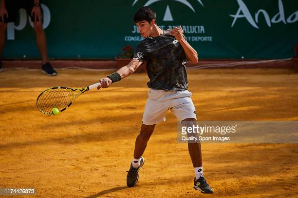 Carlos Alcaraz of Spain returns a shot during his round of 16 match against Pedro Martinez Portero of Spain on day 3 of ATP Sevilla Challenger at...
