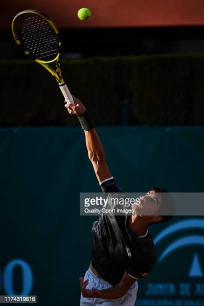 Carlos Alcaraz of Spain serves a ball during his round of 16 match against Pedro Martinez Portero of Spain on day 3 of ATP Sevilla Challenger at Real...