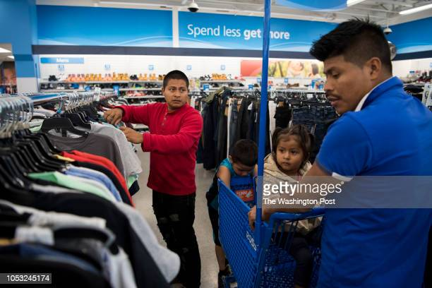 Carlos Aldana and his brother Rodolfo Aldana go shopping to buy Carlos and his daughter Alejandra clothes at Ross Dress for Less in Seattle,...