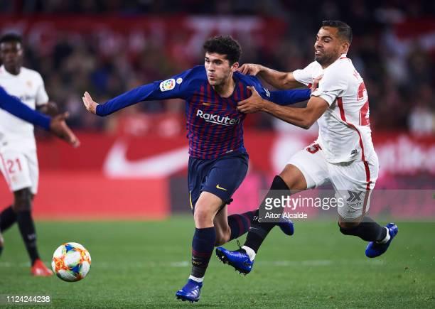 Carlos Alena of FC Barcelona competes for the ball with Gabriel Mercado of Sevilla FC during the Copa del Quarter Final match between Sevilla FC and...
