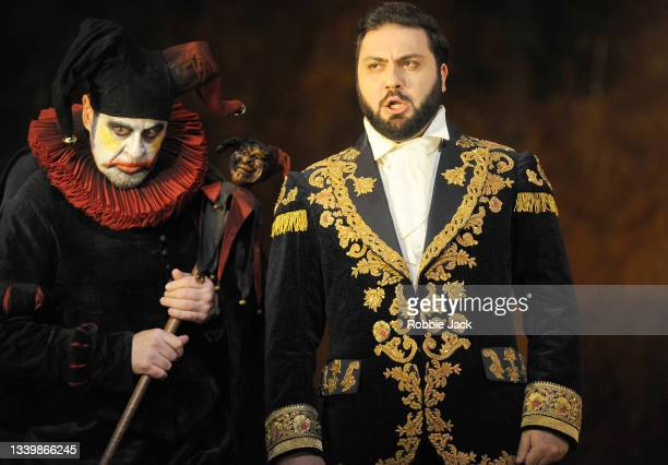Carlos Alvarez as Rigoletto and Liparij Avetisyan as Duke of Mantua in Giuseppe Verdi's Rigoletto directed by Oliver Mears and conducted by Antonio...