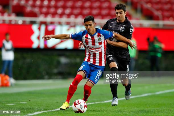 Carlos Antuna of Chivas fights for the ball with John Medina of Monterrey during the 10th round match between Chivas and Monterrey as part of the...