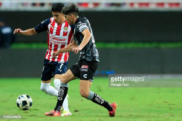 Carlos Antuna of Chivas fights for the ball with Kevin Álvarez of Pachuca during the 9th round match between Chivas and Pachuca as part of the Torneo...