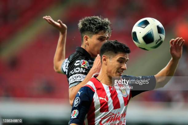 Carlos Antuna of Chivas jumps for the ball with Kevin Álvarez of Pachuca during the 9th round match between Chivas and Pachuca as part of the Torneo...